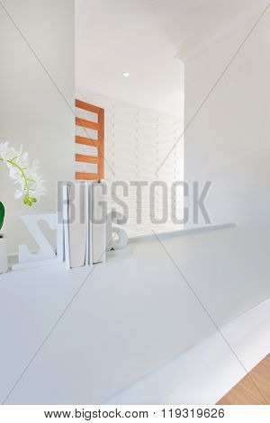 Closeup Of A Small Book Shelf On The Empty White Table Decorated With 3D Letters