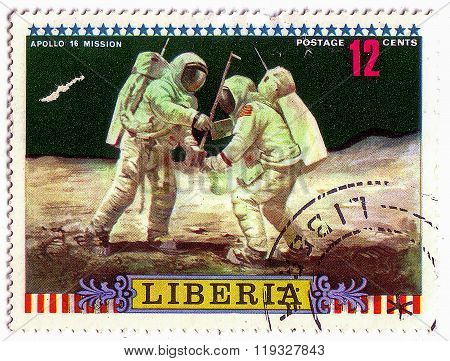 Liberia - Circa 1972: A Post Stamp Printed Liberia Shows Moon Mission Of Apollo 16 Setting Up Equipm