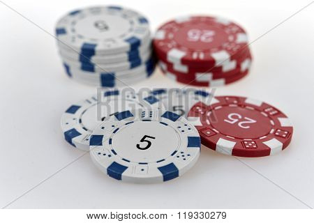 Casino Chips On A White Table