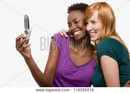 Friends photographing themselves with cell phone