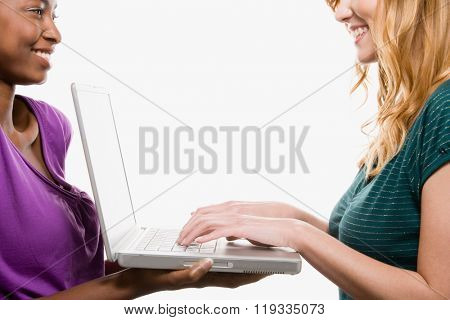 Friends using laptop
