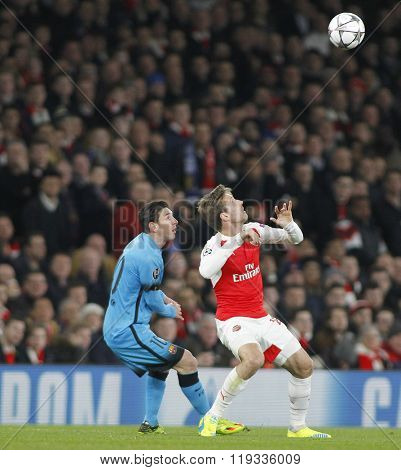 LONDON, ENGLAND - FEBRUARY 23: Lionel Messi of Barcelona and Nacho Monreal of Arsenal during the Champions League match between Arsenal and Barcelona at The Emirates Stadium
