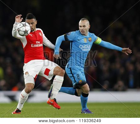 LONDON, ENGLAND - FEBRUARY 23: Francis Coquelin of Arsenal and Andres Iniesta of Barcelona during the Champions League match between Arsenal and Barcelona at The Emirates Stadium