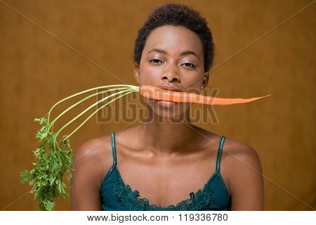 Woman with a carrot in her mouth