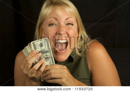 Attractive Woman Excited About her Stack of Money She Holds.