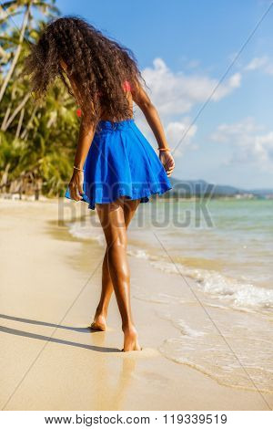Beautiful Teenage Black Girl In Blue Skirt On The Beach.