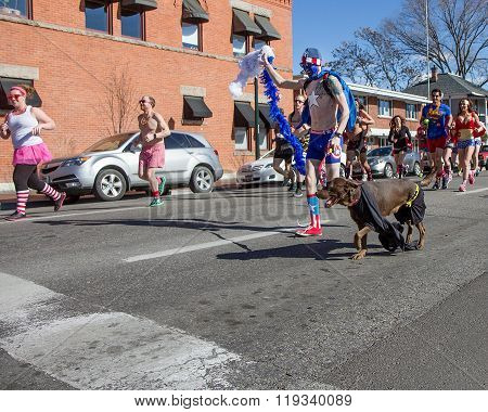 Boise, Idaho/usa February 13, 2016: Man And Dog Run The Cupids Undie Run In Boise, Idaho
