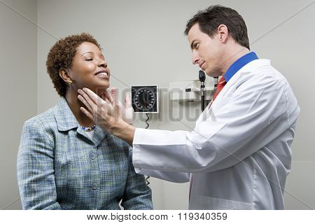 Doctor checking womans throat