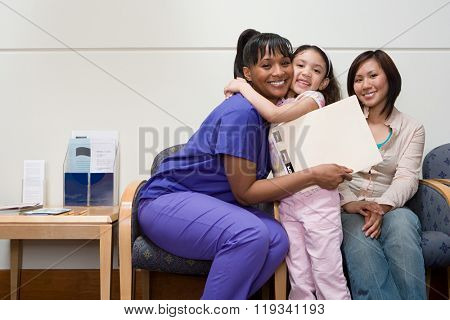 Girl hugging nurse
