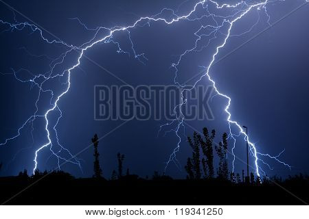 Double Trouble Cloud to Ground Lightning Silhouette Ground Line