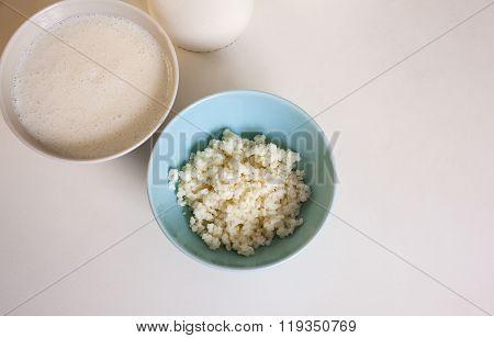 Organic probiotic milk kefir grains inside the bowl poster