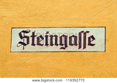 Old street sign of Steingasse street in Dinkeslbuhl one of the best-preserved medieval towns in Europe part of the famous Romantic Road tourist route in Germany.