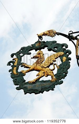 DINKELSBUHL GERMANY - AUGUST 10 2015: A wrought iron hanging sign in Dinkelsbuhl one of the best-preserved medieval towns in Europe part of the famous Romantic Road tourist route