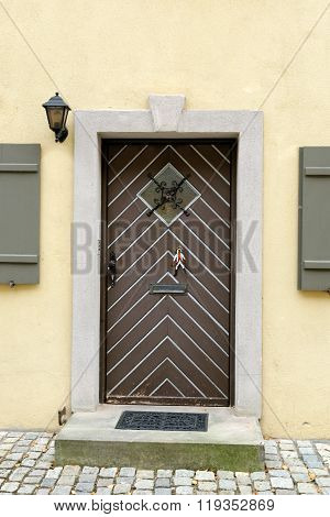 Old house entrance door in Dinkelsbuhl Germany. It is one of the best-preserved medieval towns in Europe part of the famous Romantic Road tourist route.