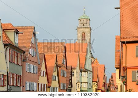 Traditional architecture in the old town of Dinkelsbuhl Germany at sunset. It is one of the best-preserved medieval towns in Europe part of the famous Romantic Road.