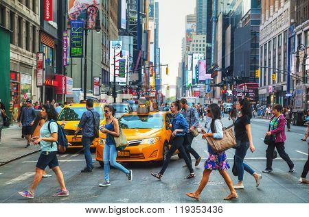 People Crossing A Street In New York