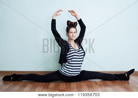 Ballet. Portrait Of A Teenage Girl With Bow- Knot Hairdo Sitting On Twine