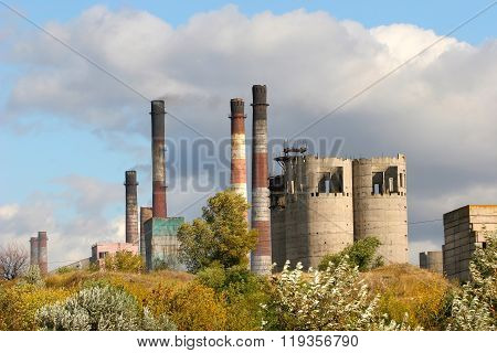 Smokestacks Adversely Affect The Environment And The Surrounding Plants. Factory Pipes Smoke And Pol