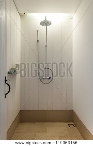 Big white modern shower cabin in apartment interior