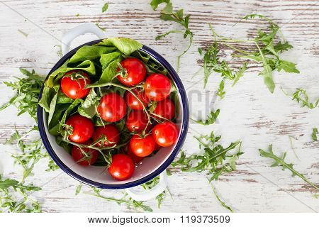 Cherry Tomatoes, Eruca Sativa, Rucola, Fresh Green Salad Leaves Copyspace Background  Isolated Over