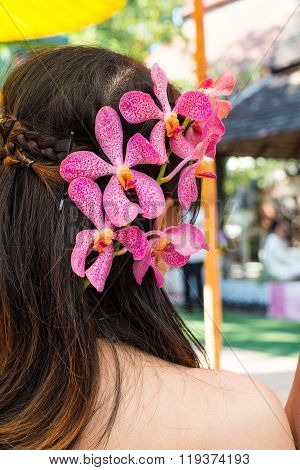 The Orchid Decorate On Women's Head
