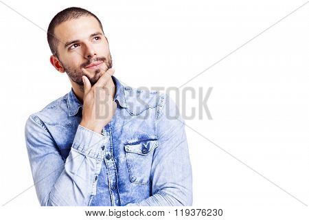 Handsome casual man thinking and looking at copyspace, isolated on white background