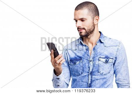 Casual man reading a message on his smartphone, isolated on white background
