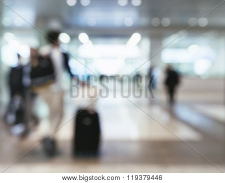 Traveling People With Baggage Walking In Train Station Blur Background