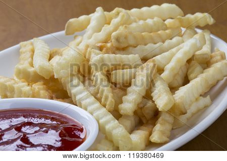 Delicious Crinkle Cut Style French Fries With Ketchup