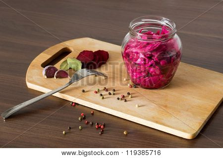 Sauerkraut With Beets And Spices In A Glass Jar