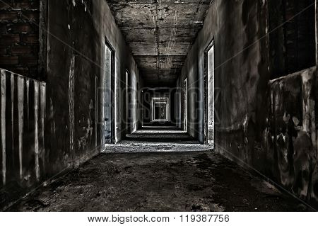 scary hallway walkway in abandoned building in dark poster