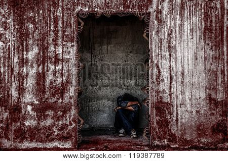 Some People Sitting In Scary Abandoned Building With Blood Wall And Many Ghost Hand Coming Out Of A