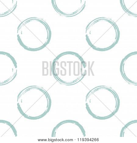 Light greenish blue grunge circles on white background