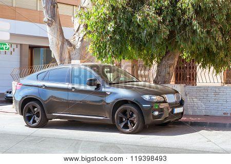 Black Modern Car Bmw X6 Series On Sunny Street, Torrevieja, Valencia, Spain
