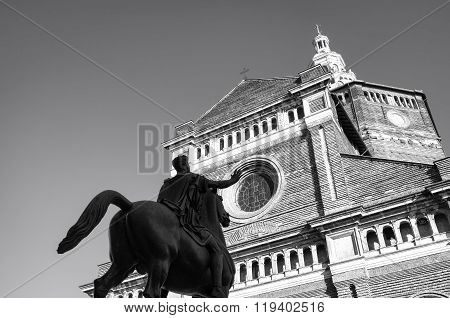 Pavia, St. Stefano Cathedral with Regisole statue. Black and white photo