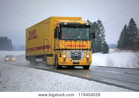 Yellow Renault Magnum Semi Truck Hauls In Winter