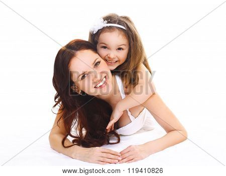 Happy Smiling Mother And Little Child Daughter On A White Background