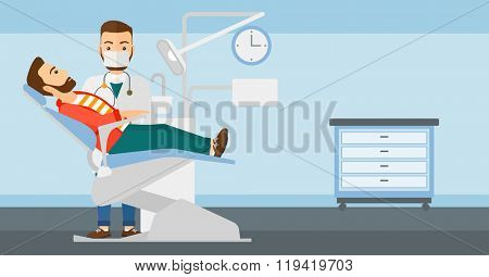 Dentist and man in dentist chair.
