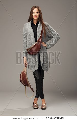 Elegant Model In Gray Woven Cardigan With Two Leather Fanny Packs.