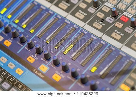 Professional music mixer console with faders and adjusting knobs close up poster