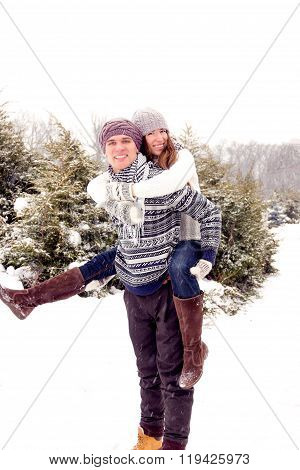 Happy Adult Couple In Park In Winter
