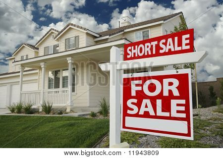Short Sale Home For Sale Real Estate Sign and House - Right Side.