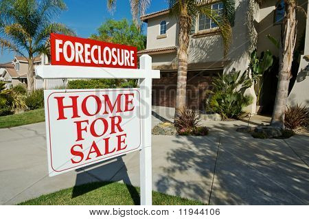Foreclosure For Sale Real Estate Sign in Front of Beautiful New Home