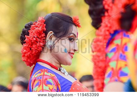 KOLKATA INDIA - MARCH 5 2015 : Young girl dancer's joyful expression at Holi / Spring festival known as Dol (in Bengali) or Holi (in Hindi) celebrating arrival of Spring in India. A very popular festival amongst Bengalis.