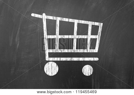 Shopping Cart Symbol On Blackboard