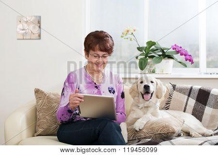 Modern senior woman with dog
