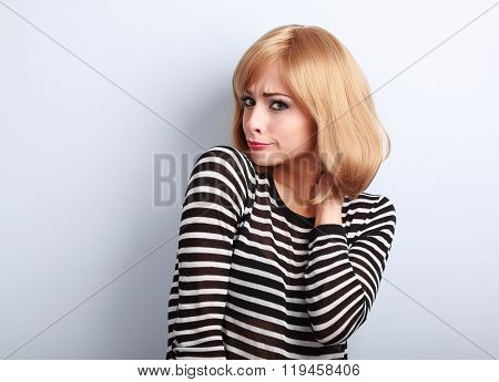 Displeased Suspicious Blond Woman Looking Skeptical On Blue Background