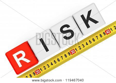 Measure Risk Concept. Risk Cubes With Measuring Tape