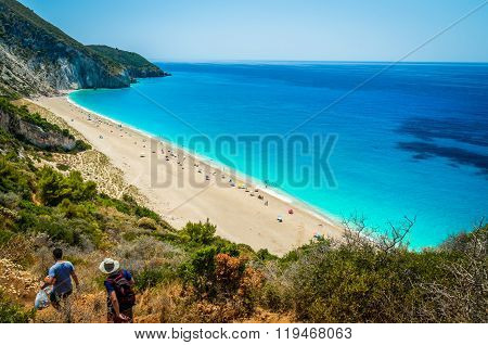 MILOS BEACH, LEFKADA ISLAND, GREECE - JULY 15 2015: People going to the beach. Milos beach is one of the most famous beach in Greece.