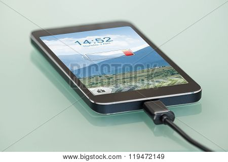 Cellphone With Low Battery Symbol On Charge